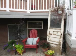 Outdoor room vignette - Old door with wreath and window